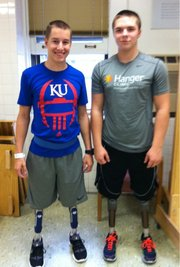 Colby Liston, left, an 18-year-old KU student from Derby, met fellow double leg amputee Seth Alexander, a high school senior from Shell City, Mo., recently at KU Hospital. Liston said it was helpful to speak to Alexander, who lost his legs a year ago and has been through the rehabilitation Liston is beginning.