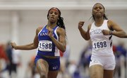 Kansas sprinter Paris Daniels slows after the finish of the women&#39;s 60-meter dash at the Bob Timmons Challenge on Thursday, Dec. 6, 2012 in Anschutz Pavillion at Kansas University. At right is Latoya King of Lincoln.