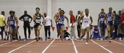 Kansas sprinter Paris Daniels, center, takes off to a first place finish in the fourth heat of the Women's 60 Meter Dash event during the Bob Timmons Challenge on Thursday, Dec. 6, 2012 in Anschutz Pavillion at Kansas University. Also pictured from left are Tianna Valentine, Kansas, Cornesha Wilkerson, Oral Roberts, Latoya King, Lincoln and Francine Simpson, Kansas.