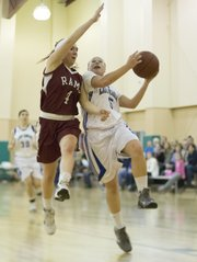Veritas&#39; Tori Huslig (5) sails past Kara Kahn as she drives in for a lay up during Veritas&#39; game against Hymand Brand, Thursday, Dec. 6, 2012 in Eudora.