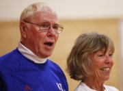 Former KU physical education instructor Bob Lockwood, a pioneer of plyometric training, watches the workout with Liberty Memorial Central teacher Michel Loomis.