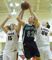 Free State's Chelsea Casady (32) beats a double team of Jasmine Meyer (15) and Morgan Bromell (44) during Free State's match up against Lansing, Saturday, Dec. 8, 2012 in Lansing.