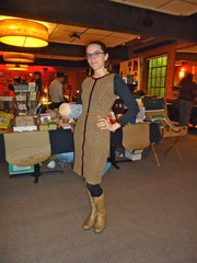 Meredith Moore, Lawrence. Clothing details: Earrings, Wonder Fair, Scarlet Garnet, yesterday, $58; dress, Nomads, 2 weeks ago, $80; belt, Vintage, years ago, 10 cents; boots, TJ Maxx in Cape Cod, 3 years ago.