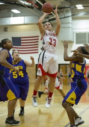 Lawrence High's Kionna Coleman (33) puts up a shot after finding a hole in the defense during Lawrence High's game against Harmon, Monday, Dec. 10, 2012 at LHS.