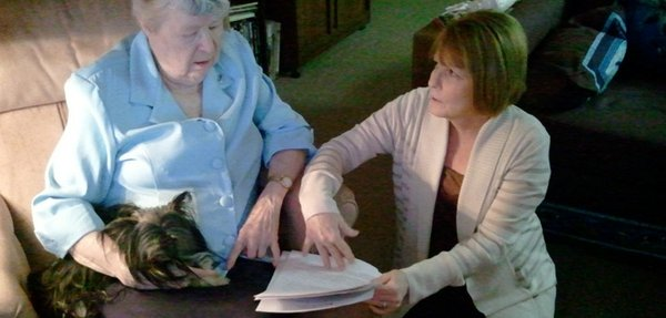 Monica Anderson, right, a case manager with the Johnson County Area Agency on Aging, goes over some paperwork with client Patti Rogers. The two have worked together for seven years, and Rogers said she's sorry she has to change case managers because of the overhaul of the Kansas Medicaid program.