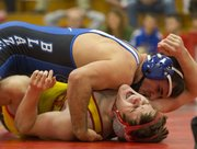Lawrence High senior Andrew Denning, bottom, winces in pain as Dustin Williams pulls him down to the mat during Lawrence High's wrestling meet against Gardner-Edgerton, Wednesday, Dec. 12, 2012 at LHS.