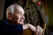 World War II veteran, Jarek Piekalkiewicz fought with the Polish resistance during the Warsaw Uprising of 1944 and was held as a prisoner of war in Germany until liberated by U.S. forces on April 1, 1945. Piekalkiewicz, who is pictured on Wednesday, Dec. 12, 2012, is a subject of a new book, Needle in the Bone, by Lawrence author, Caryn Miriam Goldberg. The book explores stories of survival and a friendship between Piekalkiewicz and Holocaust survivor Lou Frydman. Nick Krug/Journal-World Photo