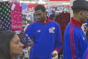 KU junior Justin Wesley sports a broken finger as he looks for gifts on Thursday, Dec. 13, 2012, during the Jayhawks' holiday shopping excursion to Wal-Mart.