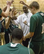 Former Kansas University player and current Barstow head coach Billy Thomas gathers this team for a huddle during Seabury's game against Barstow, Thursday, Dec. 13, 2012 at Seabury.