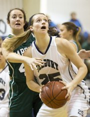 Seabury's Courtney Hoag (25) makes a post move around Tess Phillips during Seabury's game against Barstow, Thursday, Dec. 13, 2012 at Seabury.