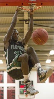 Free State's Khadre Lane throws down a dunk during Lawrence High's game against Free State, Friday, Dec. 14, 2012 at LHS.