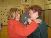 Hillcrest School Principal Tammy Becker, left, congratulates Kathy Bowen Friday on being named the Lawrence Master Teacher for 2012-13. Sunset Hill Principal Chris Bay is in the background.