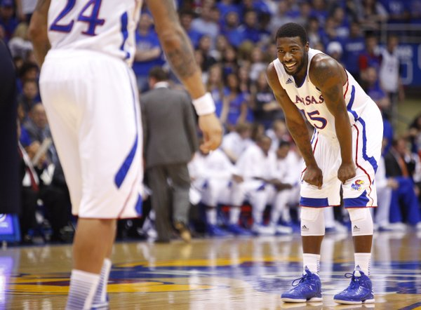 Kansas guard Elijah Johnson smiles after a dunk by teammate Travis Releford against Belmont during the first half on Saturday, Dec. 15, 2012 at Allen Fieldhouse.