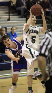Seabury Academy senior Brandon McCaffrey (5) shoots against Axtell's Derek Porter (31) on Saturday, Dec. 15, 2012, at Seabury. The Seahawks boys lost, 63-55.