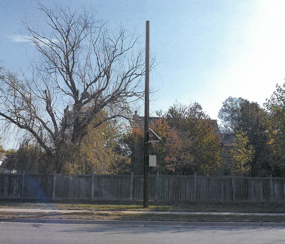 A photo illustration of what a Black Hills meter reading pole may look like in a Lawrence neighborhood. Courtesy of: City of Lawrence.