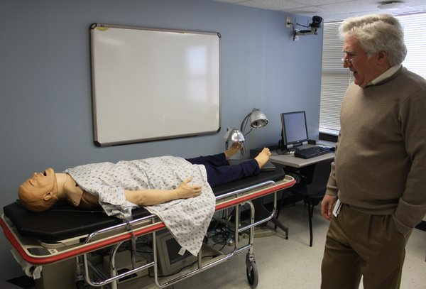 The KU School of Medicine has a few practice rooms intended to simulate for students the clinical conditions they would experience in a hospital as doctors. Mannequins can be programmed to display certain heart patterns and other conditions. Cameras are mounted in each of the practice rooms so instructors can monitor and later critiques the students' work. KU officials say a new building with more of these types of spaces that encourage learning by doing and by working in teams are needed for the school to maintain its accreditation. Dr. Glen Cox, right, is a dean at the medical school and is among the few faculty members who remember the last time the school had accreditation problems in the 1990s.