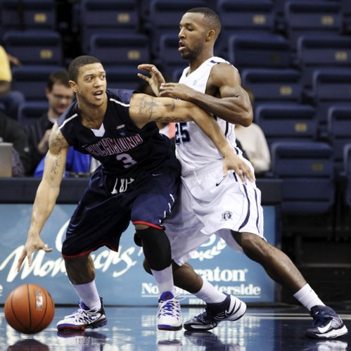 Old Dominion's Donte Hill, right, defends Richmond's Darien Brothers during their game, Tuesday, Dec. 4, 2012, in Norfolk, Va.