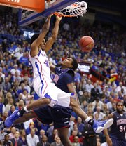 Kansas forward Kevin Young gets a put-back dunk over Richmond forward Terry Allen during the first half on Tuesday, Dec. 18, 2012 at Allen Fieldhouse.