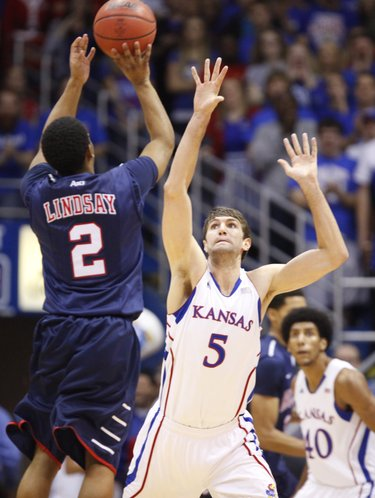 Kansas center Jeff Withey defends against a shot from Richmond guard Cedrick Lindsay during the first half on Tuesday, Dec. 18, 2012 at Allen Fieldhouse.