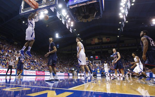 Kansas guard Ben McLemore flushes an alley-oop dunk against Richmond during the second half on Tuesday, Dec. 18, 2012 at Allen Fieldhouse.