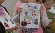 Students at Prairie Park School display their own published books on Tuesday Dec, 18, 2012. The books were printed and bound by Studentreasures Publishing, a Topeka-based company.