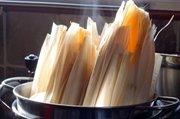 To cook the tamales, steam them for a least an hour.