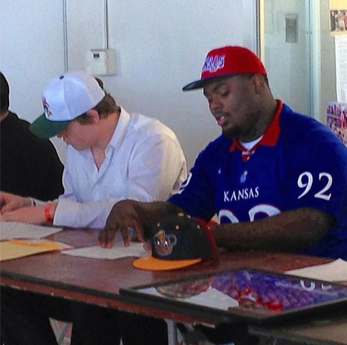 Here's the photo of Marquel Combs, big No. 92, officially signing his letter of intent with the KU football program.