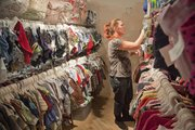Volunteer Nadean Liska, Lawrence, sorts through clothes at Doodlebugs, 816 Massachusetts St., The store buys and sells gently used children's toys and clothing.