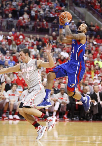 Kansas guard Travis Releford pulls up for a bucket against Ohio State guard Aaron Craft during the first half on Saturday, Dec. 22, 2012 at Schottenstein Center in Columbus, Ohio.