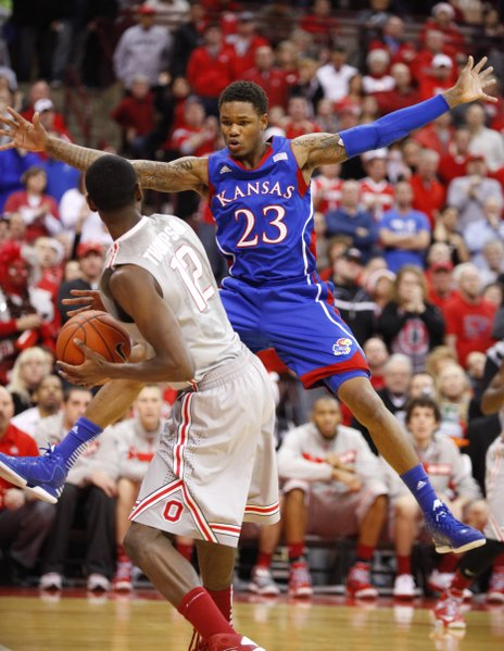 Kansas guard Ben McLemore extends all his limbs as he defends against an inbound pass from Ohio State forward Sam Thompson during the first half on Saturday, Dec. 22, 2012 at Schottenstein Center in Columbus, Ohio.