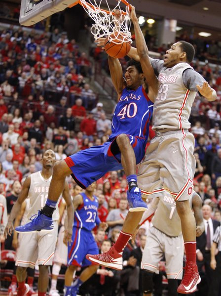 Kansas forward Kevin Young finishes a dunk and gets a foul from Ohio State center Amir Williams during the first half on Saturday, Dec. 22, 2012 at Schottenstein Center in Columbus, Ohio.