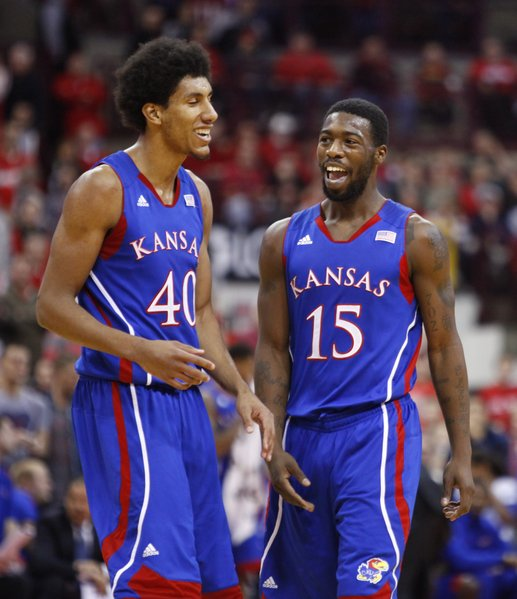 Kansas guard Elijah Johnson, right, applauds a dunk and a foul by teammate Kevin Young against Ohio State during the first half on Saturday, Dec. 22, 2012 at Schottenstein Center in Columbus, Ohio.