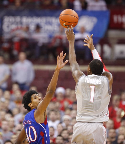 Kansas forward Kevin Young can't get there in time as Ohio State forward Deshaun Thomas puts up a three during the first half on Saturday, Dec. 22, 2012 at Schottenstein Center in Columbus, Ohio.