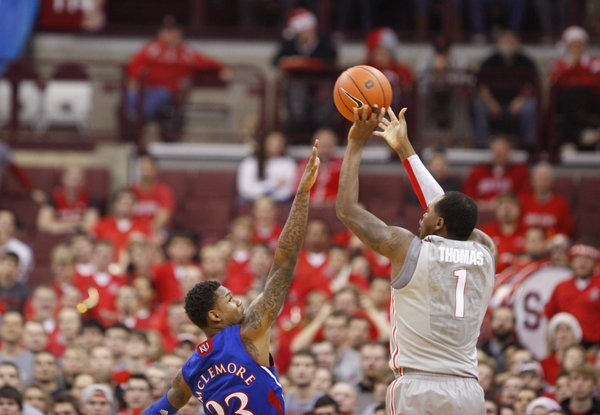 Kansas guard Ben McLemore reaches to defend against a three from Ohio State forward Deshaun Thomas during the first half on Saturday, Dec. 22, 2012 at Schottenstein Center in Columbus, Ohio.