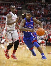 Kansas guard Elijah Johnson drives against Ohio State guard Shannon Scott during the second half on Saturday, Dec. 22, 2012 at Schottenstein Center in Columbus, Ohio.