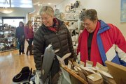 Betty Kline, Lawrence, left, and her friend Anne Band, of Rogers, Ark., view handmade items Wednesday at Phoenix Gallery, 825 Massachusetts St.