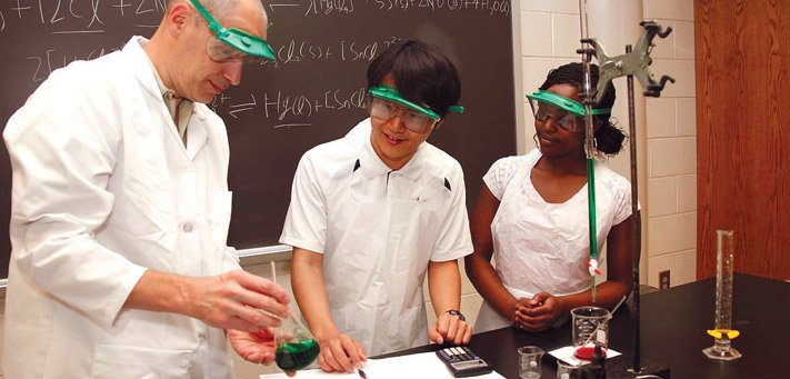 Nyasha Maforo from Winfield (right) and Soo Bum Kim from South Korea were part of the second class to attend the Kansas Academy of Mathematics and Science, where students finish their last two years of high school while taking college courses at Fort Hays State University, such as chemistry from professor Dr. Steven Donnelly.