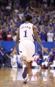 "Kansas guard Naadir Tharpe signals ""three"" after hitting one against American during the first half on Saturday, Dec. 29, 2012 at Allen Fieldhouse."