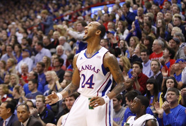 Kansas guard Travis Releford celebrates a three by teammate Ben McLemore during the second half on Saturday, Dec. 29, 2012 at Allen Fieldhouse.