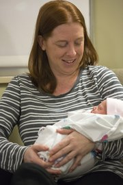 Marjorie Baker holds  newborn daughter Alexis in her room at Lawrence Memorial Hospital on Tuesday. Alexis, born at 2:51 a.m., was the first baby born in Lawrence in 2013.