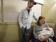 Maurice and Marjorie Baker look with their newborn daughter, Alexis, in their room at Lawrence Memorial Hospital on Tuesday. Alexis, born at 2:51 a.m. Tuesday, was the first baby of 2013 in Lawrence.