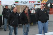 "Tonganoxie resident Tim Grant (left) of Truebud BBQ; Jeff ""Stretch"" Rumaner of Grinders, Kansas City, Mo.; and Rod Gray of Pellet Envy, Leawood, assemble in front of coolers during filming for the Kansas City episode of ""BBQ Pitmasters."" Grant&squot;s teammate Boyd Abts, Eudora, is behind him. The episode premiers at 8 p.m. Central time Sunday, Jan. 6, 2013."