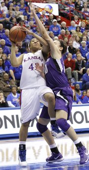 Natalie Knight (42) goes for a layup against Kansas States Bri Craig (20) during the Jayhawks 72-63 win over the Kansas State in Allen Fieldhouse, Wednesday, January 2, 2013.
