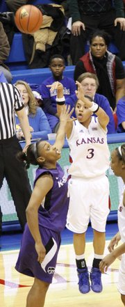 Angel Goodrich (3) launches a three-point shot in the Jayhawks 72-63 win over the Kansas State in Allen Fieldhouse, Wednesday, January 2, 2013.
