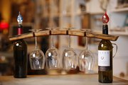 A wine glass holder created from a piece of wood from a wine barrel is among upcycled items for sale at  U.R.U Decor, 1113 Massachusetts St.