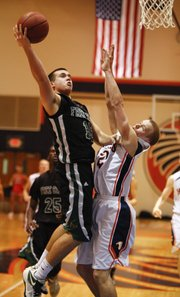 Free State guard Keith Loneker heads to the bucket on a breakaway against Olathe East guard Kyle Smith during the second half on Friday, Jan. 4, 2012 at Olathe East High School. Nick Krug/Journal-World Photo