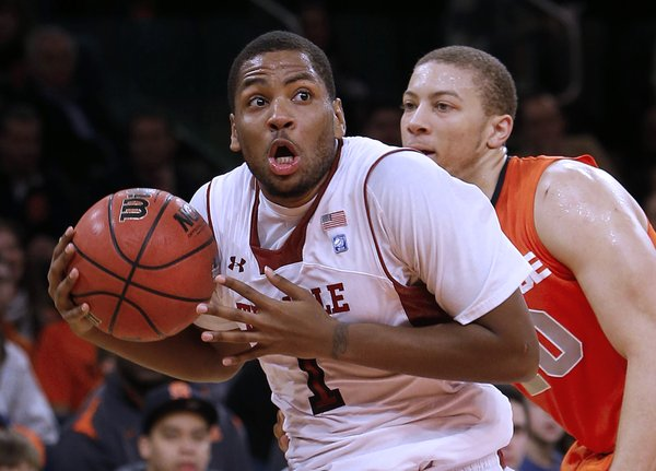 Temple's Khalif Wyatt looks to shoot after driving past Syracuse's Brandon Triche, right, during the first half of  the Gotham Classic tournament at Madison Square Garden, Saturday, Dec. 22, 2012, in New York. Temple defeated Syracuse, 83-79.