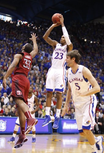 Kansas guard Ben McLemore pulls up for a three over Temple guard Scootie Randall during the first half on Sunday, Jan. 6, 2013 at Allen Fieldhouse.