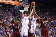 Kansas center Jeff Withey (5) and Kevin Young fight for a rebound with Temple defenders Scootie Randall and Rahlir Hollis-Jefferson during the second half on Sunday, Jan. 6, 2013 at Allen Fieldhouse.