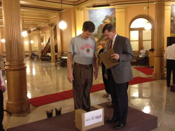 Gov. Sam Brownback weighs in for weight-loss challenge.